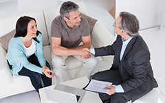 older couple meeting with divorce mediator
